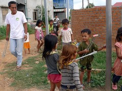 Every Friday, the priests pick up plastic trash around the office with the neighborhood children.