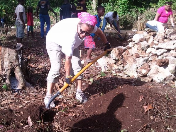 Ann Clark helping to build a school in Haiti with BuildOn